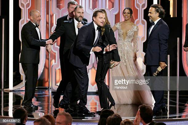 In this handout photo provided by NBCUniversal Leonardo DiCaprio accepts the award for Best Motion Picture Drama for 'The Revenant' during the 73rd...