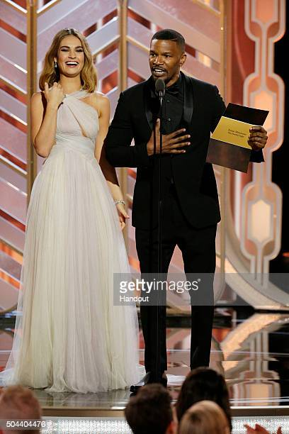 In this handout photo provided by NBCUniversal Lily James and Jamie Foxx onstage during the 73rd Annual Golden Globe Awards at The Beverly Hilton...