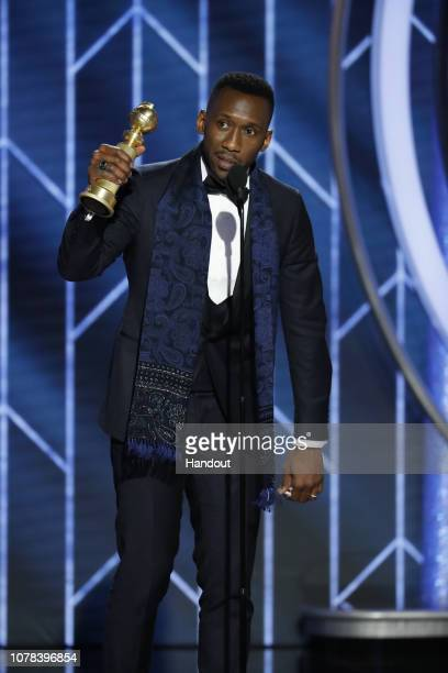 """In this handout photo provided by NBCUniversal Mahershala Ali from """"Green Book"""" accepts the Best Actor in a Supporting Role in any Motion Picture..."""