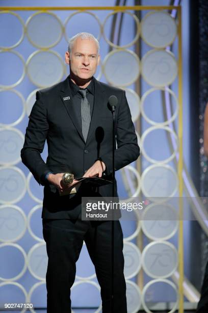 "In this handout photo provided by NBCUniversal Martin McDonagh accepts the award for Best Screenplay – Motion Picture for ""Three Billboards Outside..."