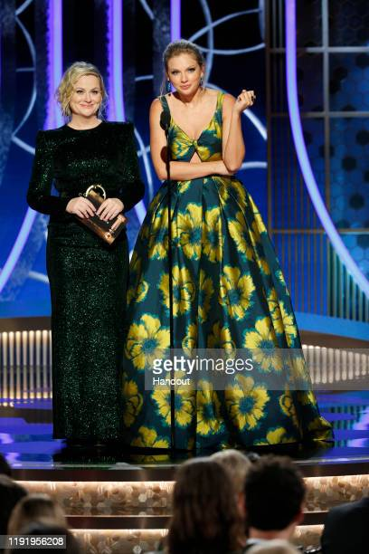 In this handout photo provided by NBCUniversal Media, LLC, Amy Poehler and Taylor Swift speak onstage during the 77th Annual Golden Globe Awards at...