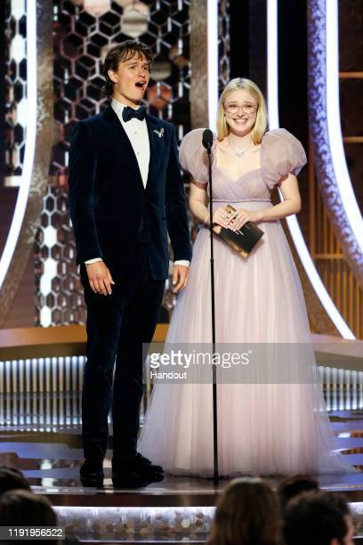 In this handout photo provided by NBCUniversal Media, LLC, Ansel Elgort and Dakota Fanning speak onstage during the 77th Annual Golden Globe Awards...