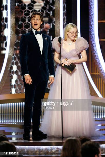 In this handout photo provided by NBCUniversal Media LLC Ansel Elgort and Dakota Fanning speak onstage during the 77th Annual Golden Globe Awards at...