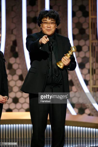 In this handout photo provided by NBCUniversal Media LLC Bong Joon Ho accepts the award for BEST MOTION PICTURE FOREIGN LANGUAGE for Parasite onstage...