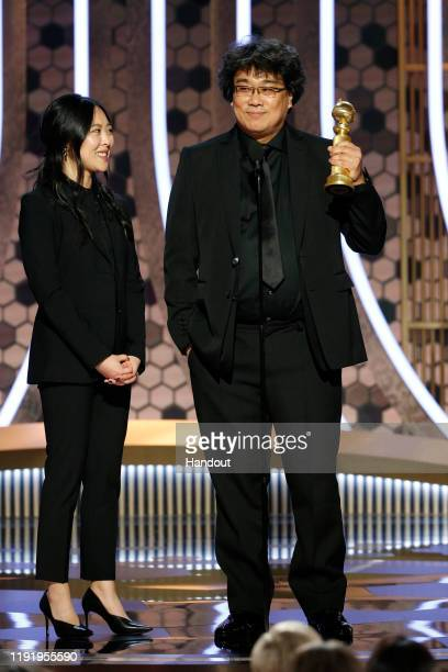 In this handout photo provided by NBCUniversal Media, LLC, Bong Joon Ho, with interpreter/translator, accepts the award for BEST MOTION PICTURE -...