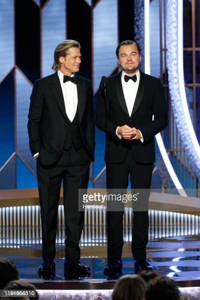 In this handout photo provided by NBCUniversal Media LLC Brad Pitt and Leonardo DiCaprio speak onstage during the 77th Annual Golden Globe Awards at...