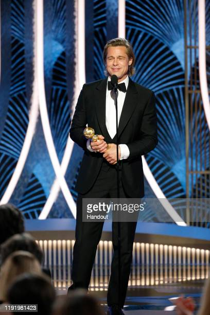 In this handout photo provided by NBCUniversal Media, LLC, Brad Pitt accepts the award for BEST PERFORMANCE BY AN ACTOR IN A SUPPORTING ROLE IN ANY...