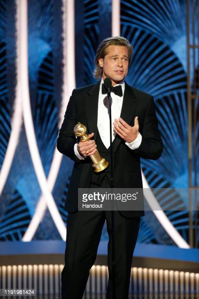 In this handout photo provided by NBCUniversal Media LLC Brad Pitt accepts the award for BEST PERFORMANCE BY AN ACTOR IN A SUPPORTING ROLE IN ANY...