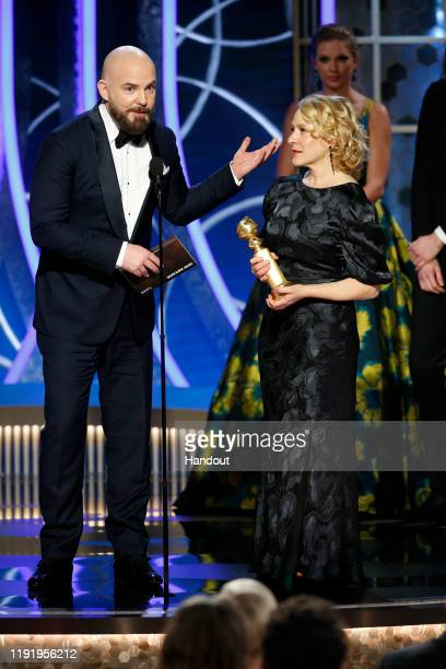 In this handout photo provided by NBCUniversal Media LLC Chris Butler and Arianne Sutner accept the award for BEST MOTION PICTURE ANIMATED for...