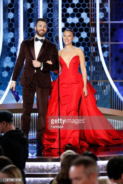 In this handout photo provided by NBCUniversal Media, LLC, Chris Evans and Scarlett Johansson onstage during the 77th Annual Golden Globe Awards at...