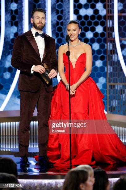 In this handout photo provided by NBCUniversal Media, LLC, Chris Evans and Scarlett Johansson speak onstage during the 77th Annual Golden Globe...