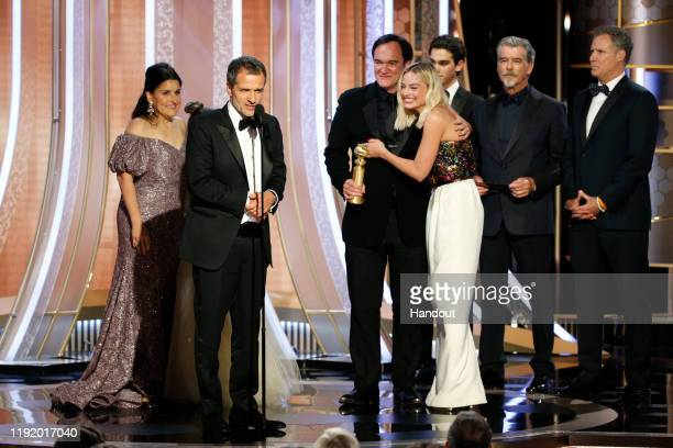 In this handout photo provided by NBCUniversal Media LLC David Heyman accepts the award for BEST MOTION PICTURE – MUSICAL OR COMEDY for Once Upon a...