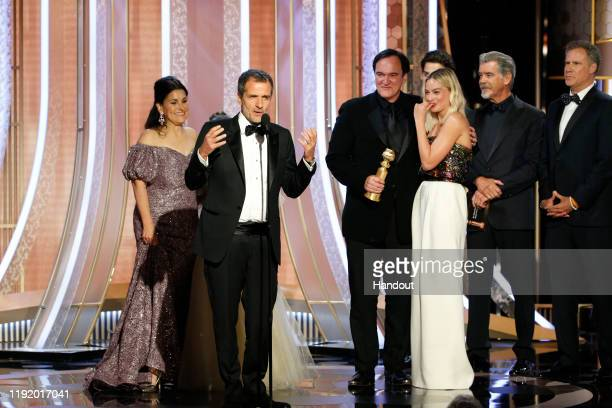 """In this handout photo provided by NBCUniversal Media, LLC, David Heyman accepts the award for BEST MOTION PICTURE – MUSICAL OR COMEDY for """"Once Upon..."""