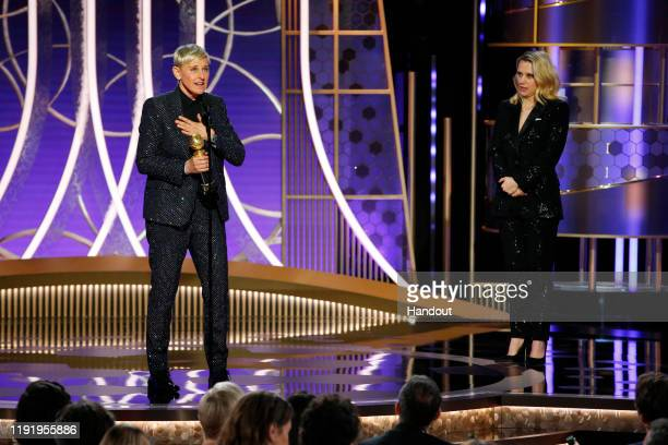 In this handout photo provided by NBCUniversal Media LLC Ellen DeGeneres accepts the CAROL BURNETT AWARD presented by Kate McKinnon onstage during...