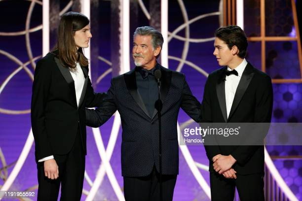In this handout photo provided by NBCUniversal Media, LLC, Golden Globe Ambassador Dylan Brosnan, father and actor Pierce Brosnan and Golden Globe...
