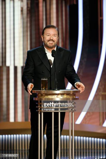 In this handout photo provided by NBCUniversal Media LLC host Ricky Gervais speaks onstage during the 77th Annual Golden Globe Awards at The Beverly...