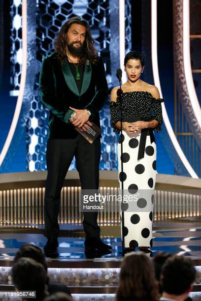 In this handout photo provided by NBCUniversal Media LLC Jason Momoa and Zoe Kravitz speak onstage during the 77th Annual Golden Globe Awards at The...