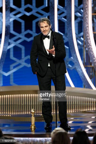 In this handout photo provided by NBCUniversal Media LLC Joaquin Phoenix accepts the award for BEST PERFORMANCE BY AN ACTOR IN A MOTION PICTURE DRAMA...