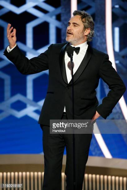 In this handout photo provided by NBCUniversal Media, LLC, Joaquin Phoenix accepts the award for BEST PERFORMANCE BY AN ACTOR IN A MOTION PICTURE -...