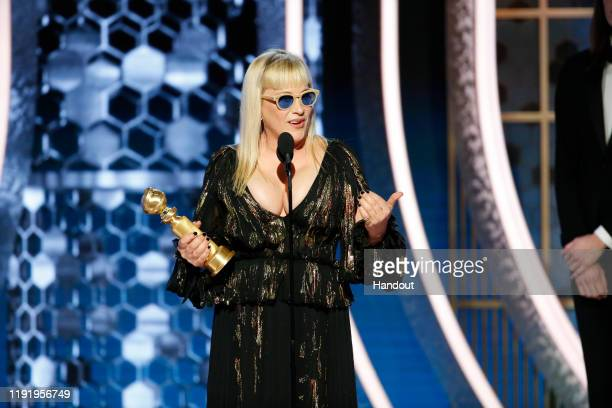 In this handout photo provided by NBCUniversal Media LLC Patricia Arquette accepts the award for BEST PERFORMANCE BY AN ACTRESS IN A SUPPORTING ROLE...