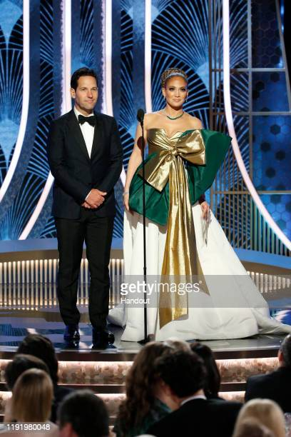 In this handout photo provided by NBCUniversal Media LLC Paul Rudd and Jennifer Lopez speak onstage during the 77th Annual Golden Globe Awards at The...