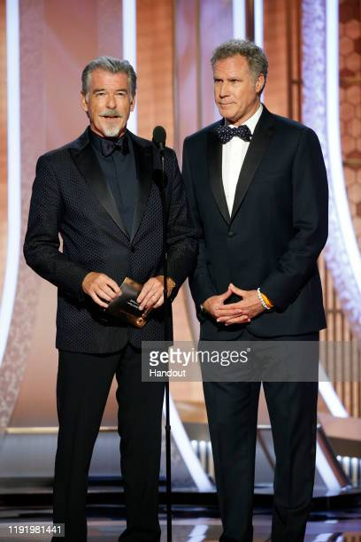 In this handout photo provided by NBCUniversal Media, LLC, Pierce Brosnan and Will Ferrell speak onstage during the 77th Annual Golden Globe Awards...