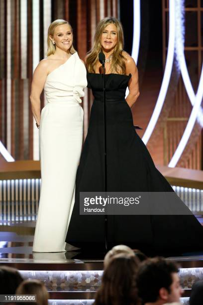 In this handout photo provided by NBCUniversal Media, LLC, Reese Witherspoon and Jennifer Aniston speak onstage during the 77th Annual Golden Globe...