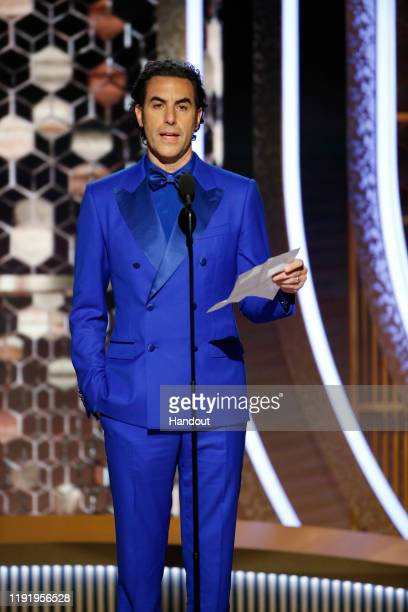 In this handout photo provided by NBCUniversal Media, LLC, Sacha Baron Cohen speaks onstage during the 77th Annual Golden Globe Awards at The Beverly...