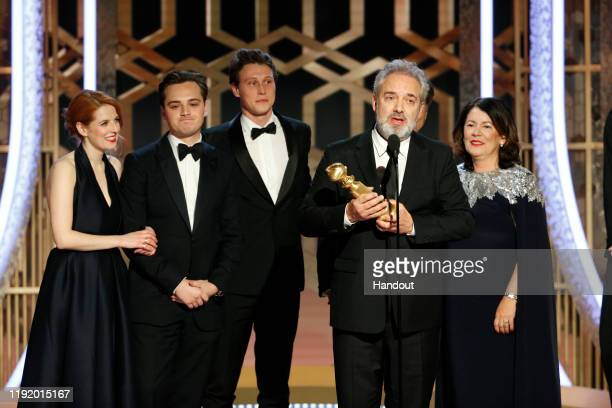 "In this handout photo provided by NBCUniversal Media, LLC, Sam Mendes accepts the award for BEST MOTION PICTURE - DRAMA for ""1917"" onstage, with..."
