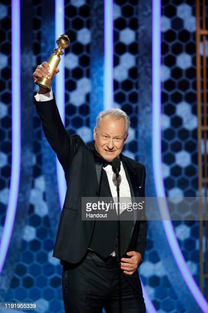 In this handout photo provided by NBCUniversal Media LLC Stellan Skarsgård accepts the award for BEST PERFORMANCE BY AN ACTOR IN A SUPPORTING ROLE IN...