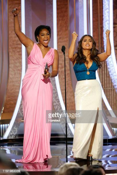 In this handout photo provided by NBCUniversal Media LLC Tiffany Haddish and Salma Hayek speak onstage during the 77th Annual Golden Globe Awards at...