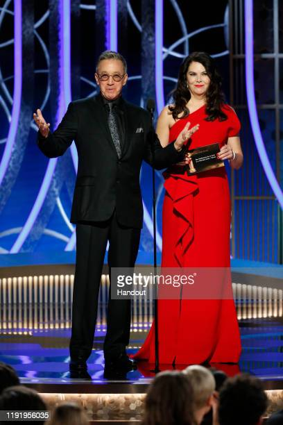 In this handout photo provided by NBCUniversal Media LLC Tim Allen and Lauren Graham speak onstage during the 77th Annual Golden Globe Awards at The...