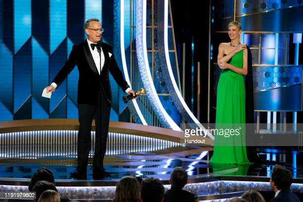 In this handout photo provided by NBCUniversal Media LLC Tom Hanks accepts the CECIL B DEMILLE AWARD presented by Charlize Theron onstage during the...
