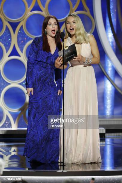 In this handout photo provided by NBCUniversal Megan Mullally and Kristin Bell speak onstage during the 76th Annual Golden Globe Awards at The...