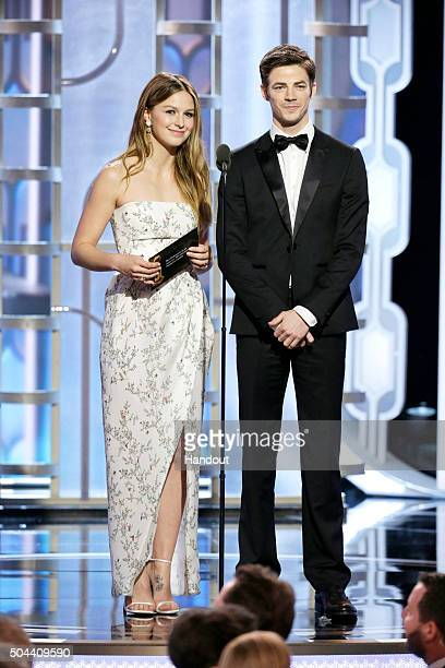 In this handout photo provided by NBCUniversal Melissa Benoist and Grant Gustin speak onstage during the 73rd Annual Golden Globe Awards at The...