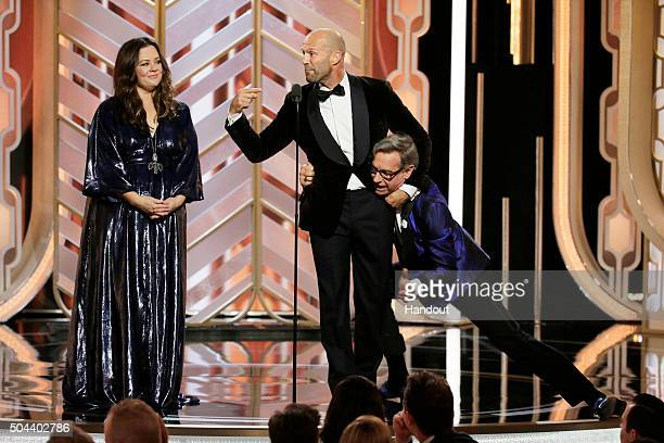 In this handout photo provided by NBCUniversal Melissa McCarthy Jason Statham and Paul Feig speak onstage during the 73rd Annual Golden Globe Awards...