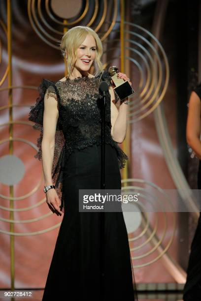 In this handout photo provided by NBCUniversal, Nicole Kidman accepts the award for Best Performance by an Actress in a Limited Series or Motion...