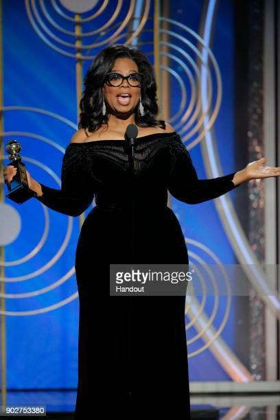 In this handout photo provided by NBCUniversal Oprah Winfrey accepts the 2018 Cecil B DeMille Award speaks onstage during the 75th Annual Golden...