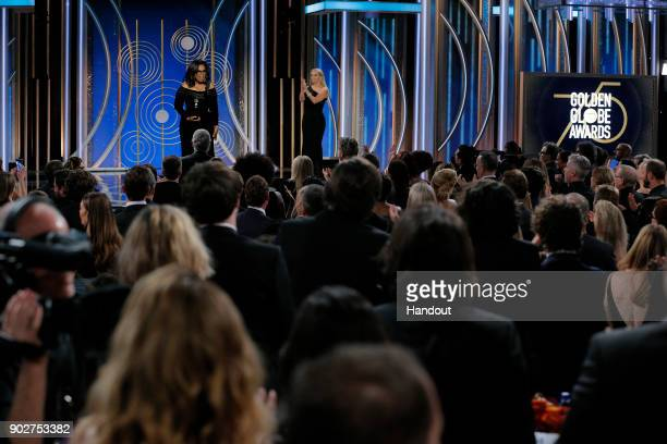 In this handout photo provided by NBCUniversal Oprah Winfrey accepts the 2018 Cecil B DeMille Award during the 75th Annual Golden Globe Awards at The...