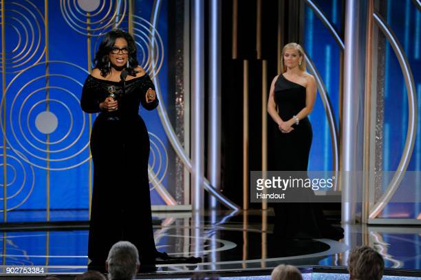 In this handout photo provided by NBCUniversal, Oprah Winfrey accepts the 2018 Cecil B. DeMille Award during the 75th Annual Golden Globe Awards at...