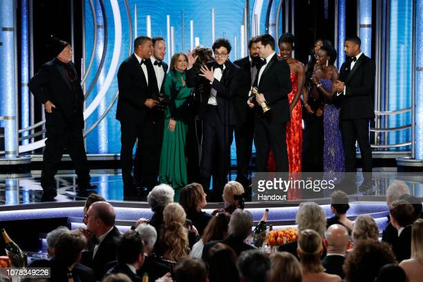 """In this handout photo provided by NBCUniversal Phil Lord from the """"SpiderMan Into the SpiderVerse"""" accepts the Best Motion Picture – Animated award..."""