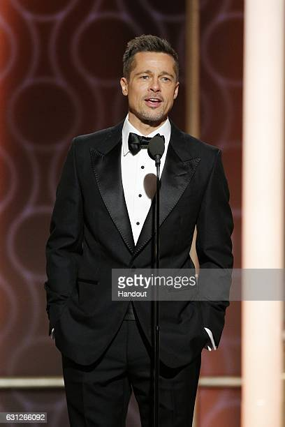 In this handout photo provided by NBCUniversal presenter Brad Pitt onstage during the 74th Annual Golden Globe Awards at The Beverly Hilton Hotel on...