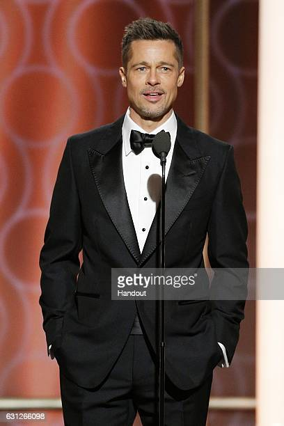 In this handout photo provided by NBCUniversal, presenter Brad Pitt onstage during the 74th Annual Golden Globe Awards at The Beverly Hilton Hotel on...