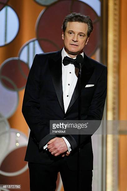 In this handout photo provided by NBCUniversal Presenter Colin Firth speaks onstage during the 72nd Annual Golden Globe Awards at The Beverly Hilton...