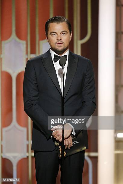 In this handout photo provided by NBCUniversal presenter Leonardo DiCaprio onstage during the 74th Annual Golden Globe Awards at The Beverly Hilton...
