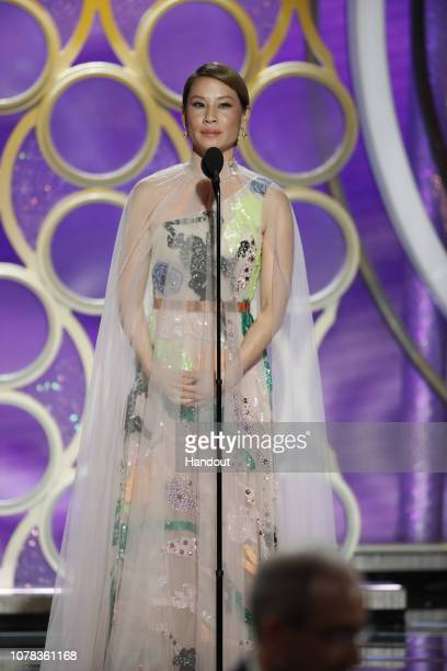 In this handout photo provided by NBCUniversal Presenter Lucy Liu speaks onstage during the 76th Annual Golden Globe Awards at The Beverly Hilton...