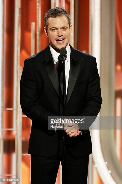 In this handout photo provided by NBCUniversal Presenter Matt Damon speaks onstage during the 73rd Annual Golden Globe Awards at The Beverly Hilton...