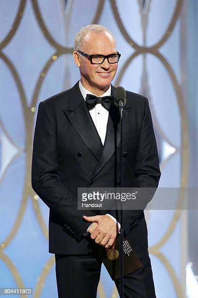 In this handout photo provided by NBCUniversal Presenter Michael Keaton speaks onstage during the 73rd Annual Golden Globe Awards at The Beverly...