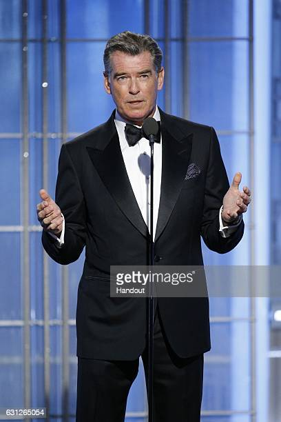 In this handout photo provided by NBCUniversal presenter Pierce Brosnan onstage during the 74th Annual Golden Globe Awards at The Beverly Hilton...