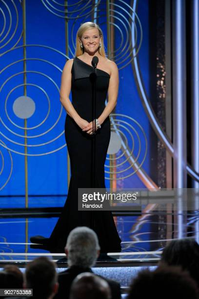 In this handout photo provided by NBCUniversal Presenter Reese Witherspoon speaks onstage during the 75th Annual Golden Globe Awards at The Beverly...